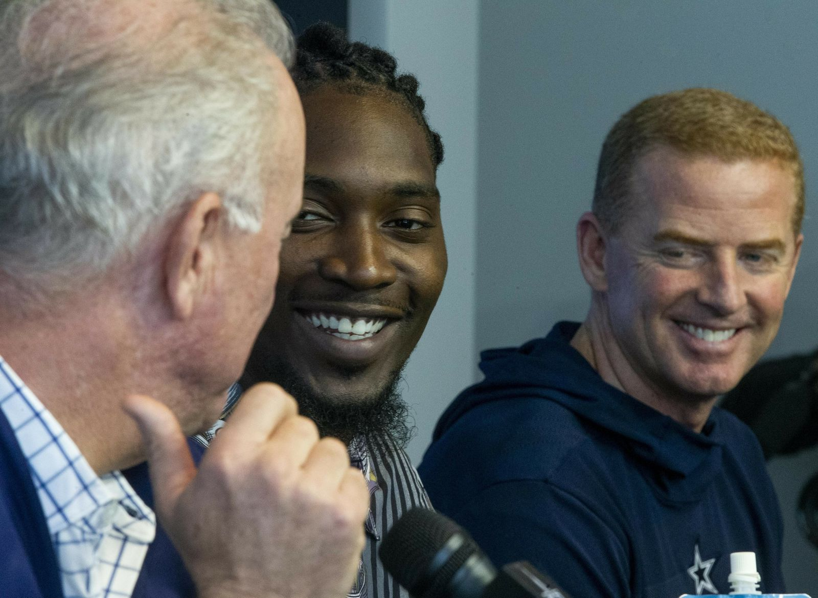 Dallas Cowboys defensive end Demarcus Lawrence, center, laughs along with CEO Stephen Jones and head coach Jason Garrett during a press conference at The Star in Frisco, Texas, Tuesday, April 9, 2019. DeMarcus Lawrence may not be the highest-paid Dallas Cowboys player in history for long. It doesn't mean the club's best defensive end can't enjoy the distinction while it lasts. The 26-year-old Lawrence signed a $105 million, five-year contract Tuesday.(Shaban Athuman/The Dallas Morning News via AP)