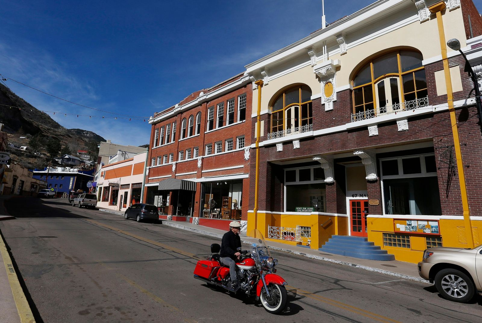 FILE - This Feb. 17, 2013 file photo shows shops and restaurants on the main street in this once bustling mining town of Bisbee, Ariz.{ } (AP Photo/Ross D. Franklin)