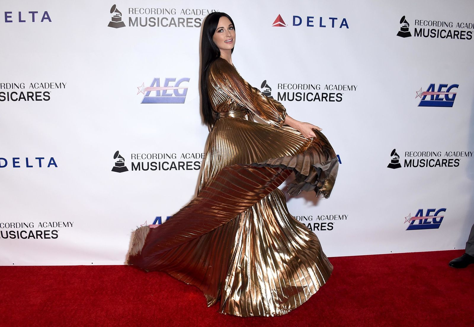 Kacey Musgraves arrives at MusiCares Person of the Year honoring Dolly Parton on Friday, Feb. 8, 2018, at the Los Angeles Convention Center. (Photo by Jordan Strauss/Invision/AP)