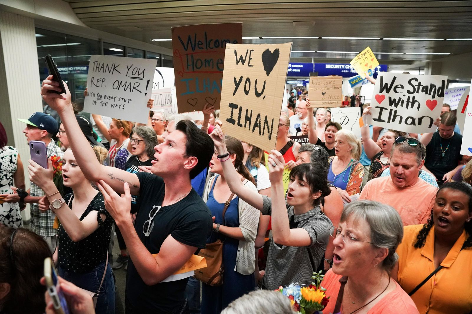 Supporters greet U.S. Rep. Ilhan Omar after she arrived home, at Minneapolis–Saint Paul International Airport, Thursday, July 18, 2019, in Minnesota. (Glen Stubbe/Star Tribune via AP)