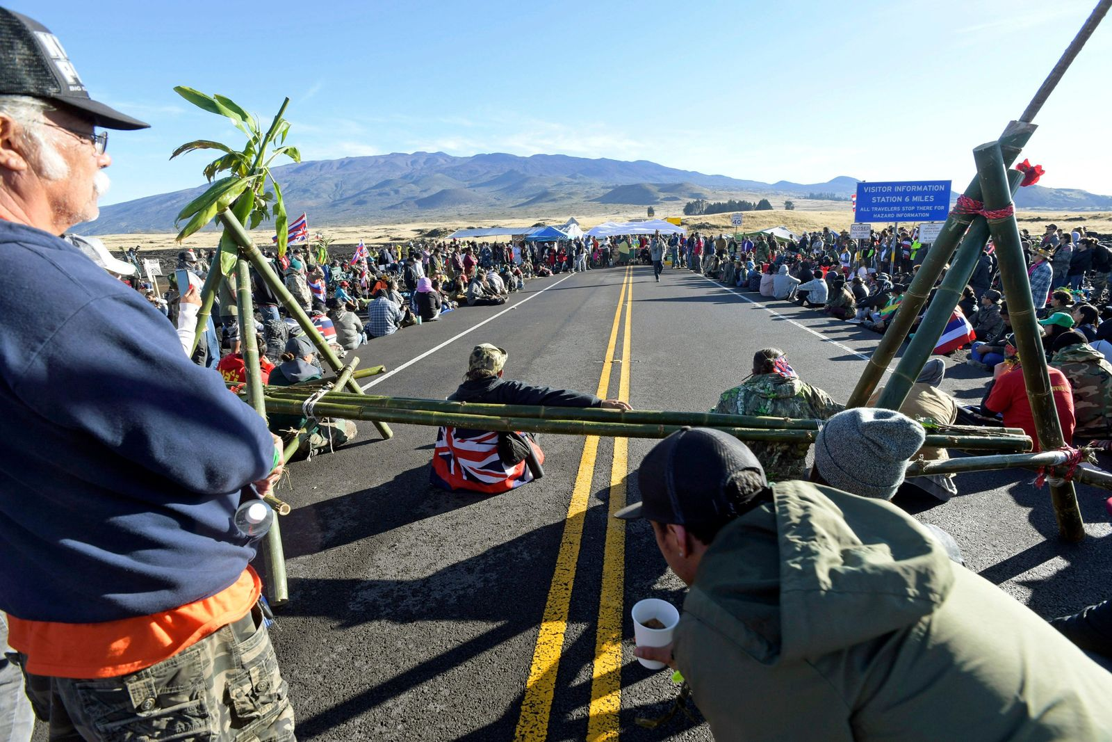 Protesters continue their opposition vigil against the construction of the Thirty Meter Telescope at Mauna Kea on the Big Island of Hawaii Friday, July 19, 2019. (Bruce Asato/Honolulu Star-Advertiser via AP)