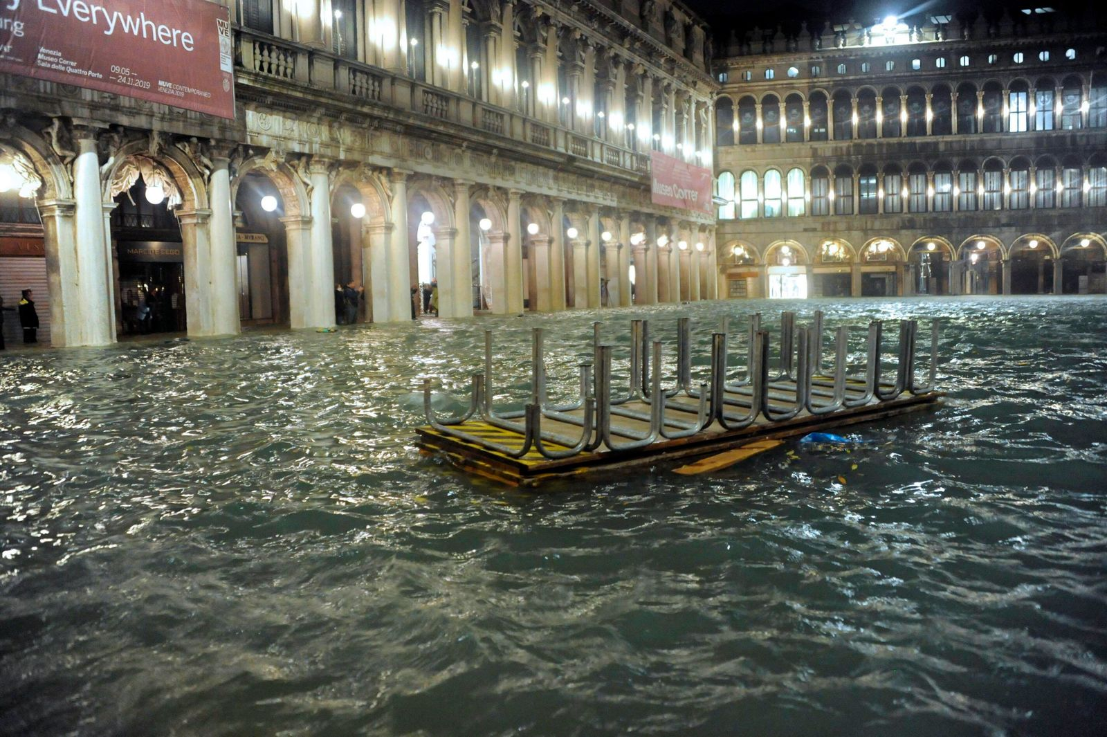 An overturned catwalk used as a walkway during high water floats in an over flooded St. Mark's Square late Tuesday, Nov. 12, 2019.{ } (Andrea Merola/ANSA via AP)