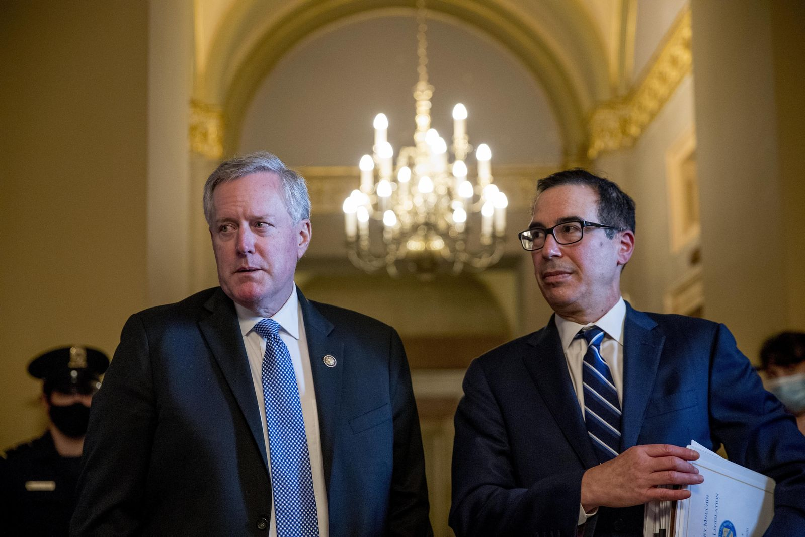 White House chief of staff Mark Meadows, left, accompanied by Treasury Secretary Steven Mnuchin, right, speaks to members of the media following a meeting with Senate Majority Leader Mitch McConnell. (AP Photo/Andrew Harnik)