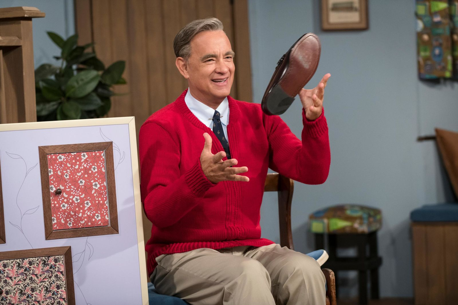 "This image released by Sony Pictures shows Tom Hanks as Mister Rogers in a scene from ""A Beautiful Day In the Neighborhood. The Mr. Rogers biopic will premiere at the Toronto International Film Festival in September. (Lacey Terrell/Sony-Tristar Pictures via AP)"