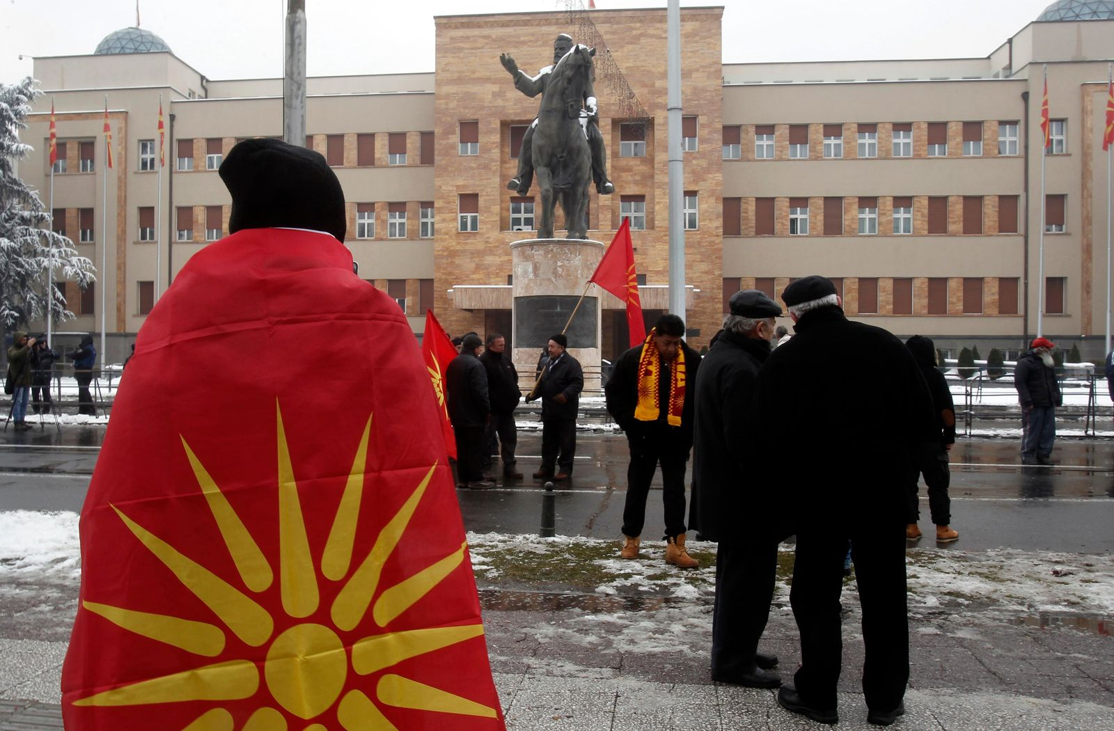 People gather to a protest against the change of the country's name outside the parliament building during a session of the Macedonian Parliament in the capital Skopje, Friday, Jan. 11, 2019. (AP Photo/Boris Grdanoski)