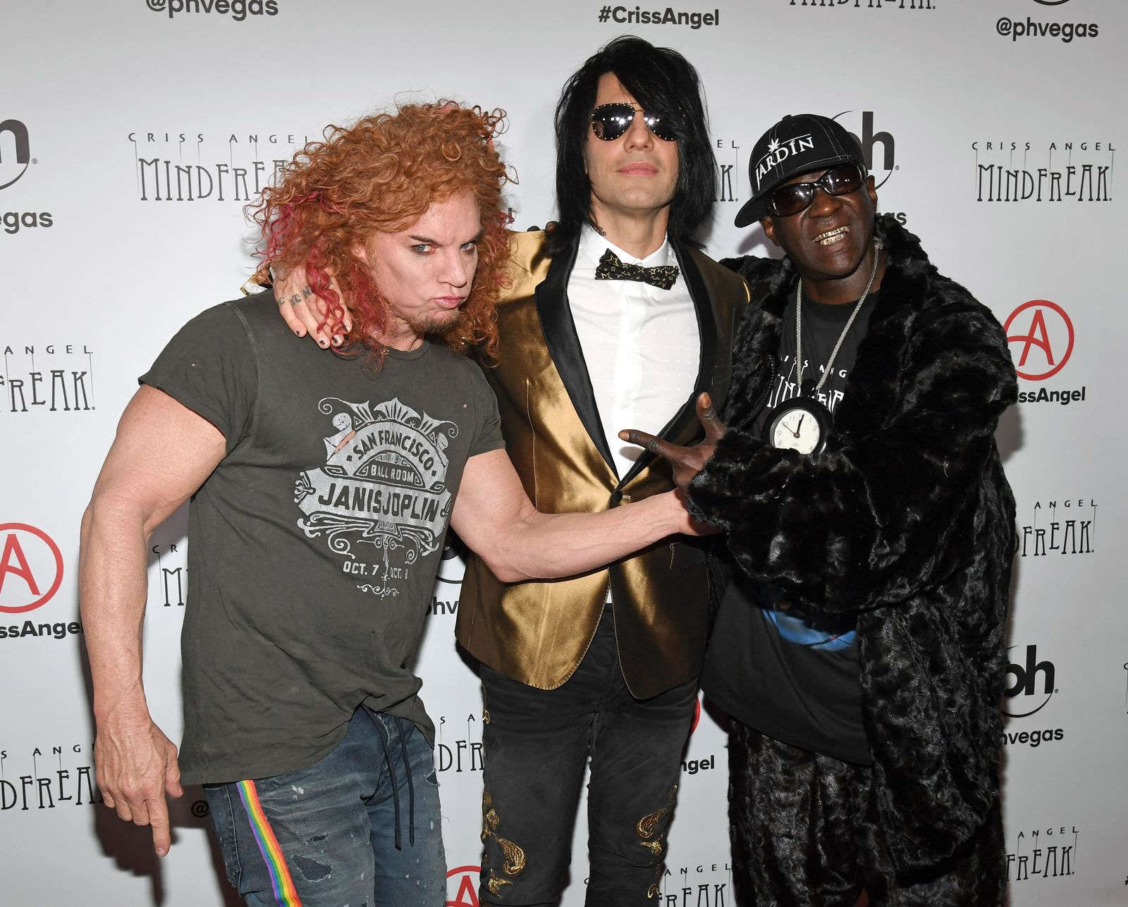 "LAS VEGAS, NEVADA - JANUARY 19:  (L-R) Comedian Carrot Top, illusionist Criss Angel and rapper Flavor Flav attend the grand opening of ""Criss Angel MINDFREAK"" at Planet Hollywood Resort & Casino on January 19, 2019 in Las Vegas, Nevada.  (Photo by Ethan Miller/Getty Images for Planet Hollywood Resort & Casino)"