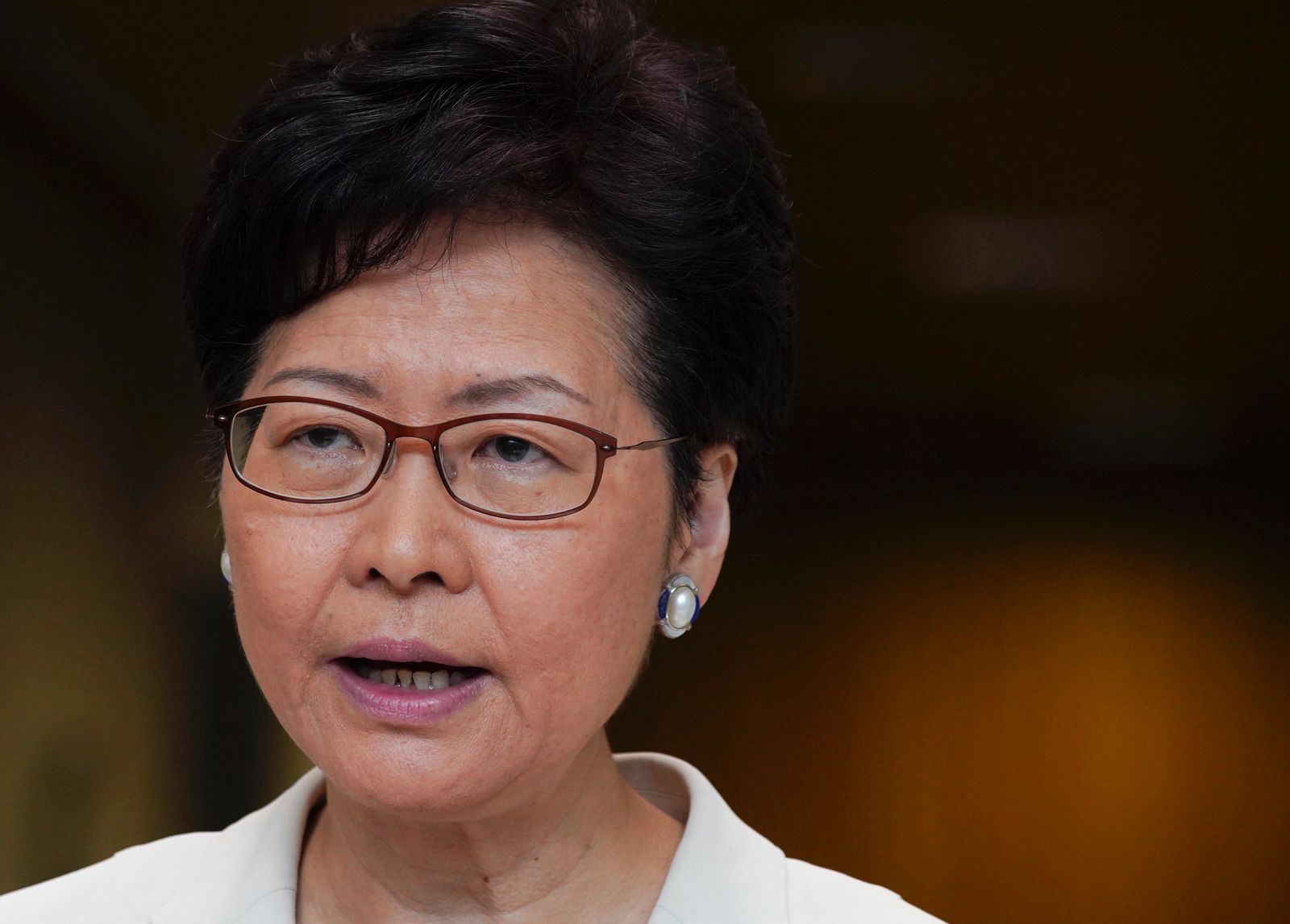 Hong Kong Chief Executive Carrie Lam speaks to reporters during a press conference at the government building in Hong Kong, Tuesday, Sept. 17, 2019. (AP Photo/Vincent Yu)