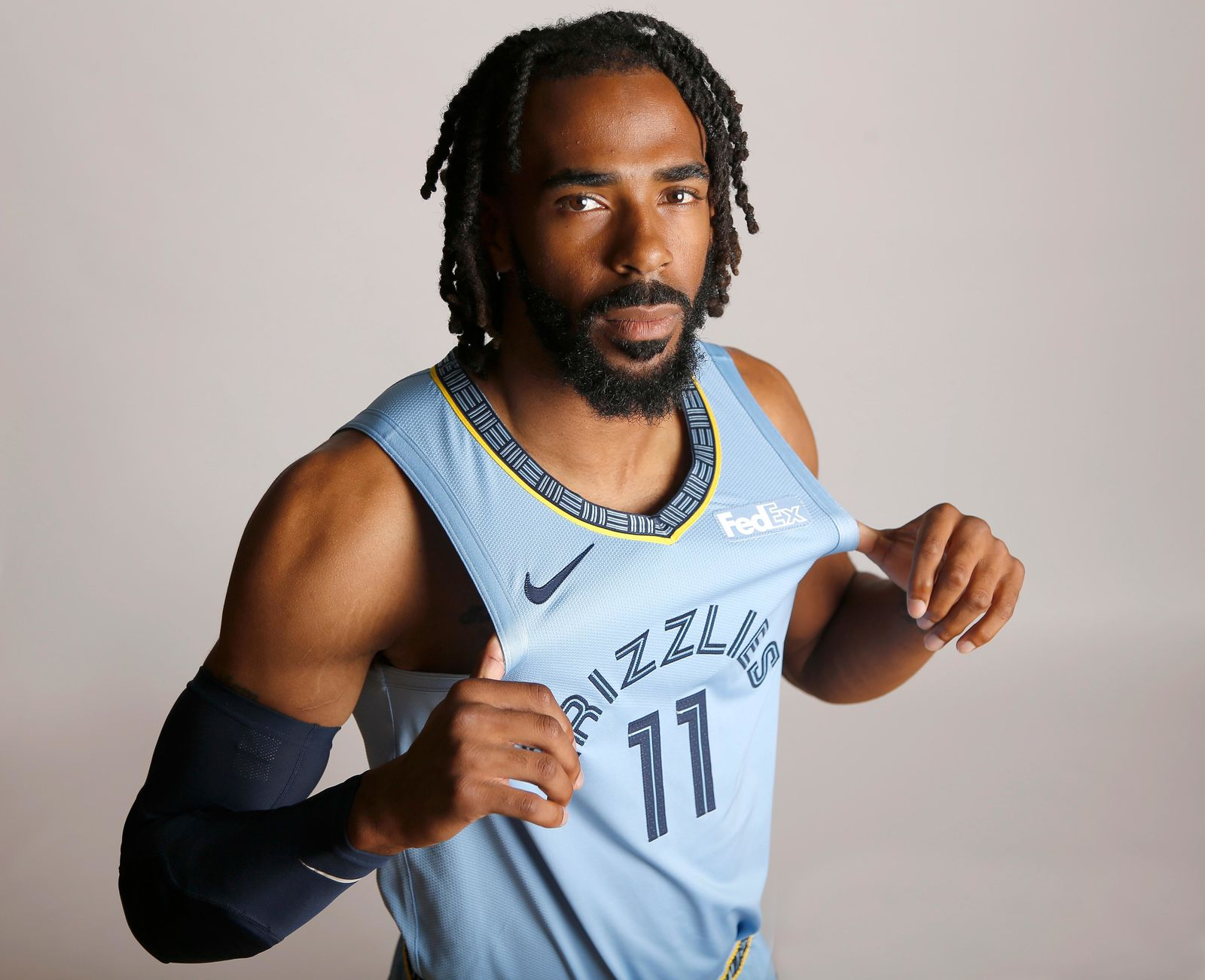 FILE - In this Sept. 24, 2018, file photo, Memphis Grizzlies guard Mike Conley poses during the team's NBA basketball media day  in Memphis, Tenn. A person with knowledge of the decision says the Memphis Grizzlies have traded veteran point guard Mike Conley, who has played the most games in franchise history, to the Utah Jazz. The person says the Grizzlies swapped Conley for Jae Crowder, Kyle Korver and Grayson Allen. The person spoke to The Associated Press Wednesday, June 19, 2019, on condition of anonymity because neither Memphis nor Utah has announced the trade. (AP Photo/File)
