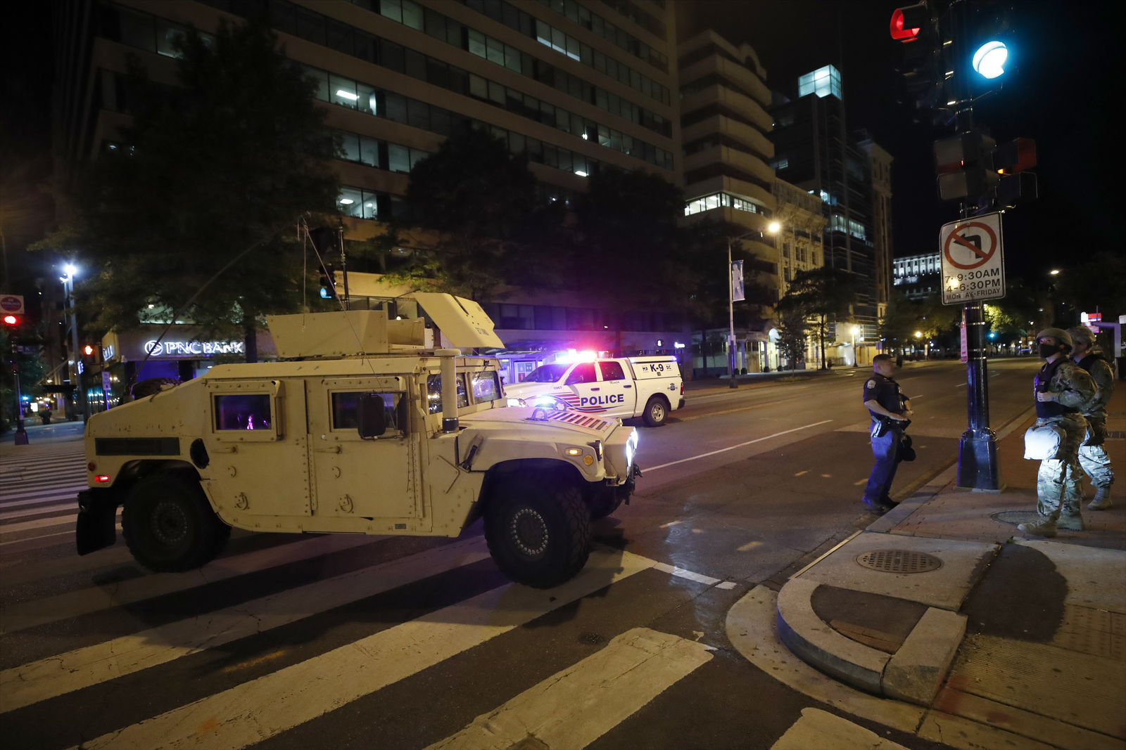 A military Humvee blocks an intersection along K Street in downtown Washington as demonstrators protest the death of George Floyd, Monday, June 1, 2020, in Washington. Floyd died after being restrained by Minneapolis police officers. (AP Photo/Alex Brandon)