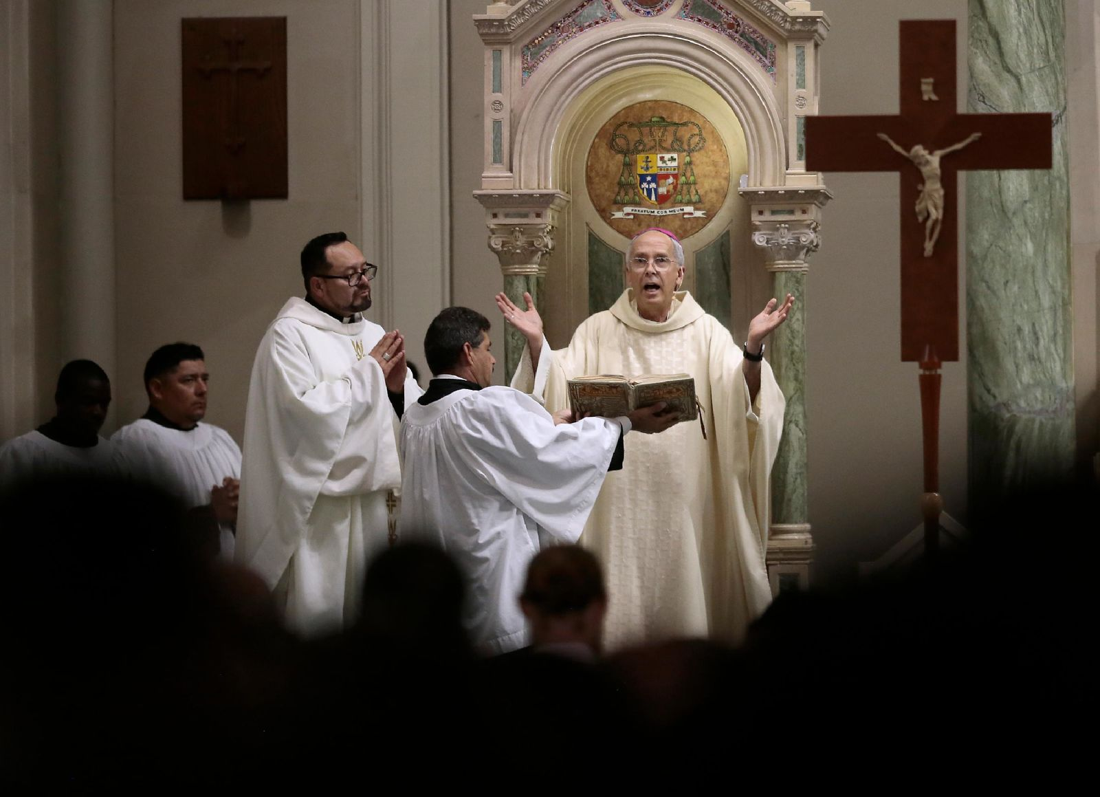Bishop Mark Seitz presides over the funeral of Andres Anchondo Friday, Aug, 16, 2019 in El Paso, Texas. Anchondo who was one of the 22 killed in the mass shooting at Walmart on August 3. (Mark Lambie/The El Paso Times via AP)