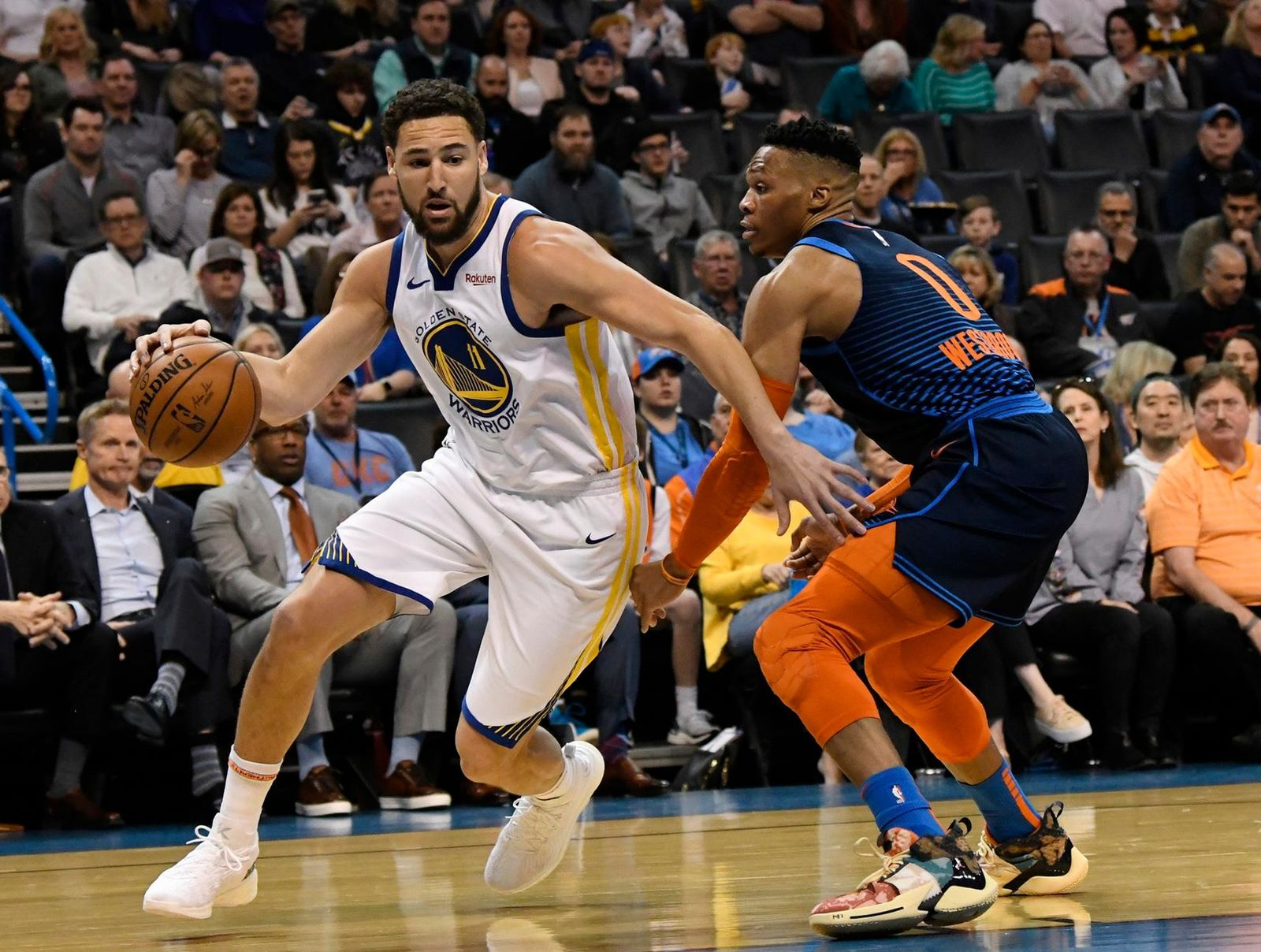 Oklahoma City Thunder guard Russell Westbrook (0) defends against Golden State Warriors guard Klay Thompson (11) during the first half of an NBA basketball game Saturday, March 16, 2019, in Oklahoma City. (AP Photo/June Frantz Hunt)