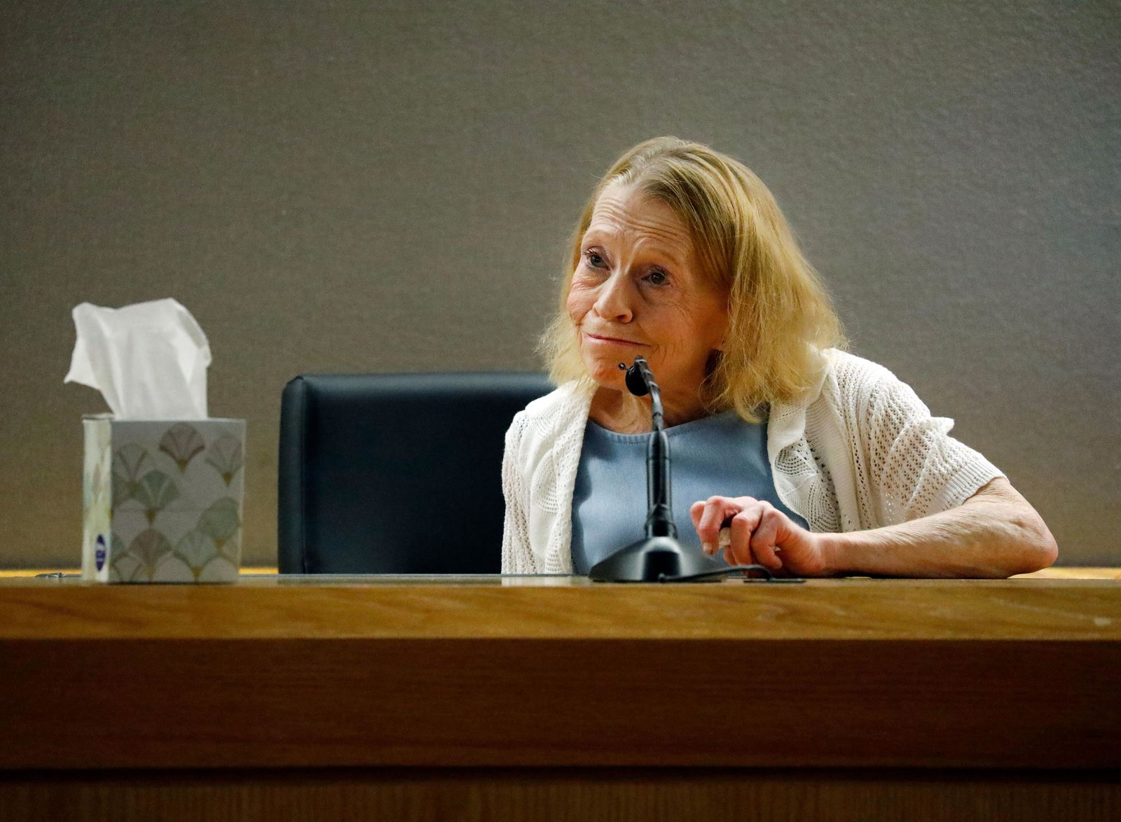 Karen Guyger speaks about her daughter former Dallas police Officer Amber Guyger on the witness stand as she is questioned by defense attorney Shelley Shook during the sentencing phase of Amber Guyger's trial, at the Frank Crowley Courts Building in Dallas, Wednesday, Oct. 2, 2019. Guyger was convicted of murder Tuesday in the killing of Botham Jean and faces a sentence that could range from five years to life in prison or be lowered to as little as two years if the jury decides the shooting was a crime of sudden passion. (Tom Fox/The Dallas Morning News via AP, Pool)