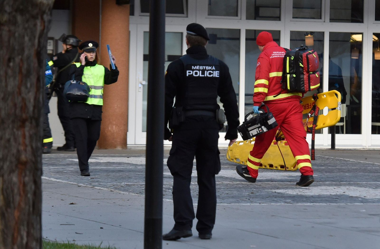 Police personnel and paramedics outside the Ostrava Teaching Hospital after a shooting incident in Ostava, Czech Republic, Tuesday, Dec. 10, 2019.{ } (Jaroslav Ozana/CTK via AP)