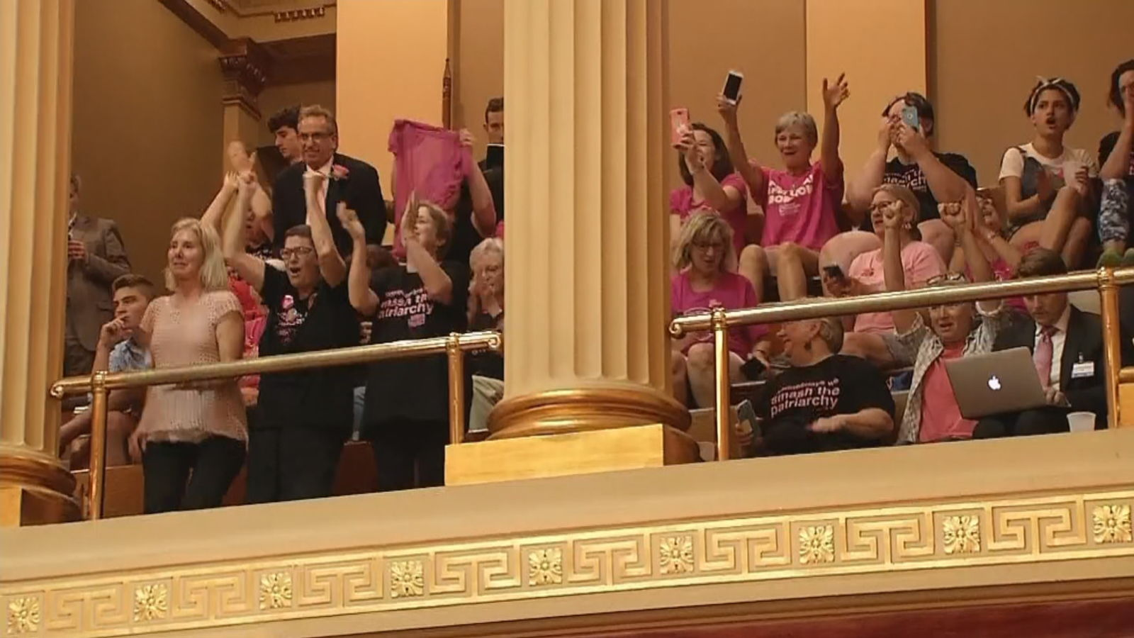 Pro-choice supporters cheer as Rhode Island lawmakers approve the Reproductive Privacy Act on Wednesday, June 1, 2019. (WJAR){ }