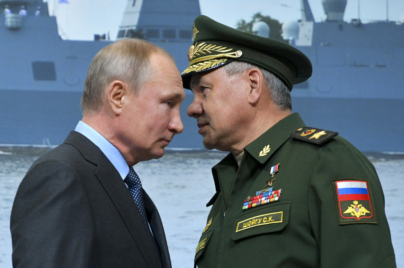 Russian President Vladimir Putin, left, and Russian Defense Minister Sergei Shoigu during a visit a shipyard in St. Petersburg, Russia, Tuesday, April 23, 2019. Putin said the government will pursue an ambitious navy modernization effort. (Alexei Druzhinin, Sputnik, Kremlin Pool Photo via AP)