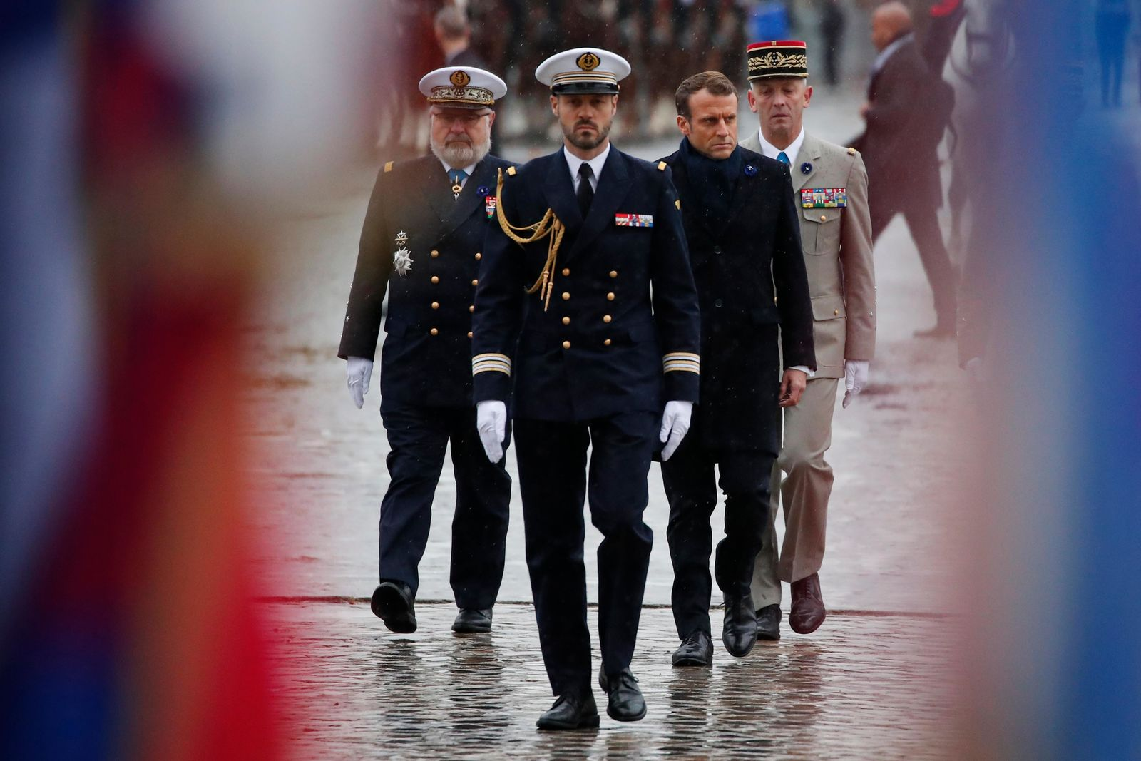 French President Emmanuel Macron, second right, arrives at the Arc de Triomphe in Paris Monday Nov. 11, 2019 before the start of the commemorations marking the 101st anniversary of the 1918 armistice, ending World War I. (AP Photo/Francois Mori, Pool)