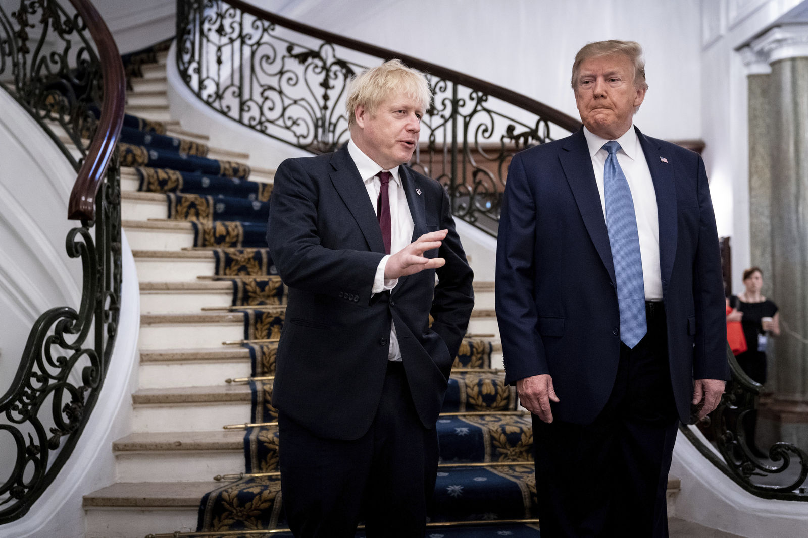 FILE - In this Aug. 25, 2019, file photo, President Donald Trump and Britain's Prime Minister Boris Johnson, left, speak to the media before a working breakfast meeting at the Hotel du Palais on the sidelines of the G-7 summit in Biarritz, France. (Erin Schaff/The New York Times, Pool, File)