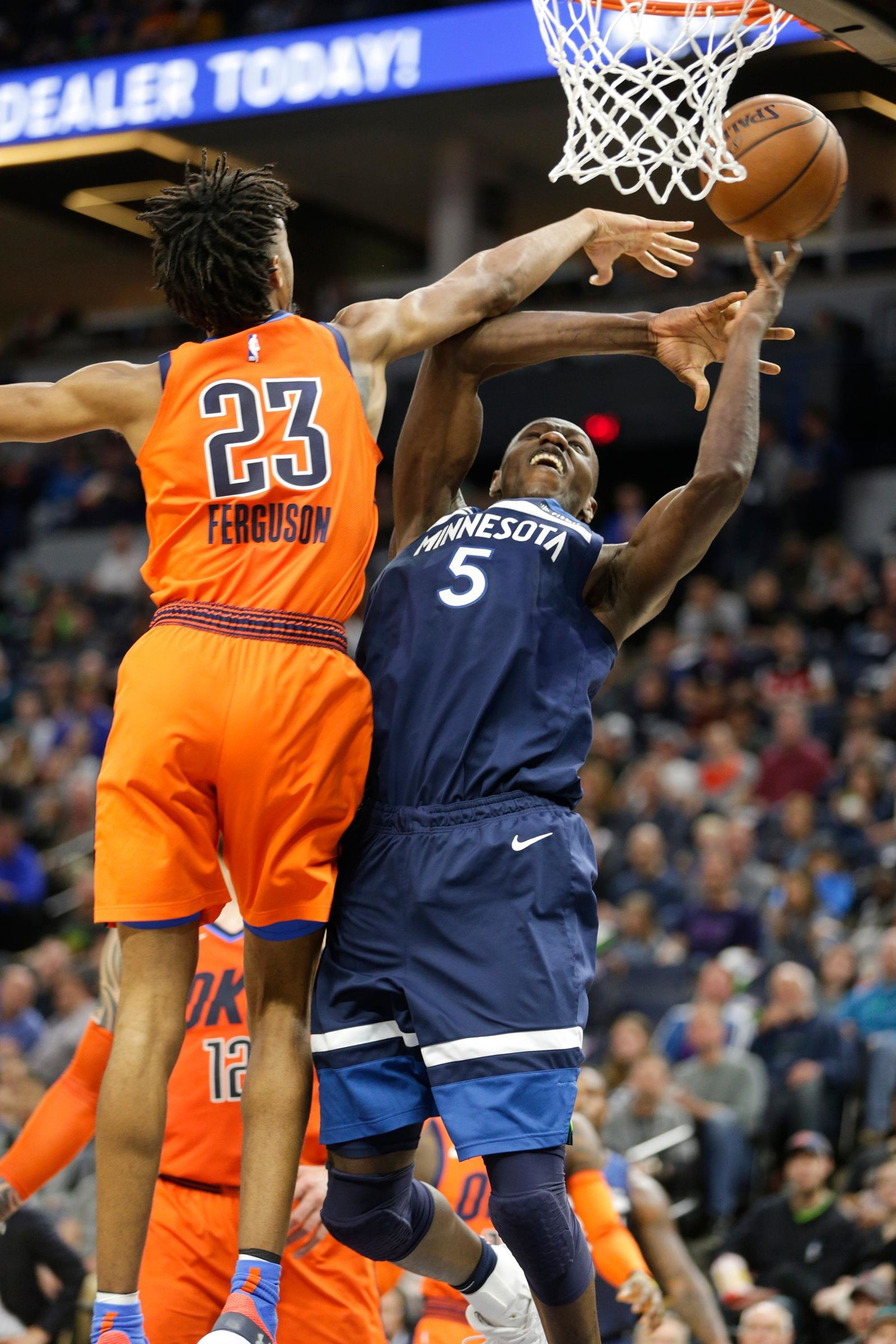 Minnesota Timberwolves center Gorgui Dieng, of Senegal, (5) is fouled by Oklahoma City Thunder guard Terrance Ferguson (23) as he goes up for a shot during the first half of a NBA basketball game Sunday, April 7, 2019, in Minneapolis. (AP Photo/Paul Battaglia)