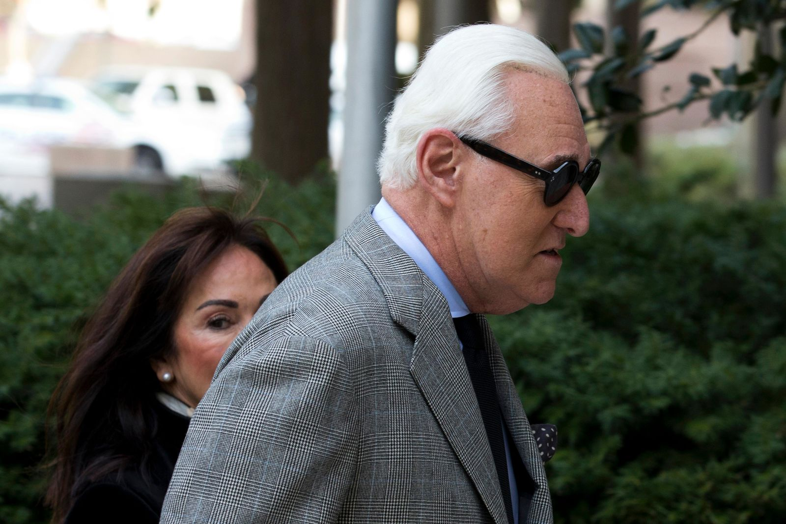 Roger Stone accompanied by his wife Nydia Stone, left, arrives at federal court in Washington, Thursday, Nov. 14, 2019. (AP Photo/Jose Luis Magana)
