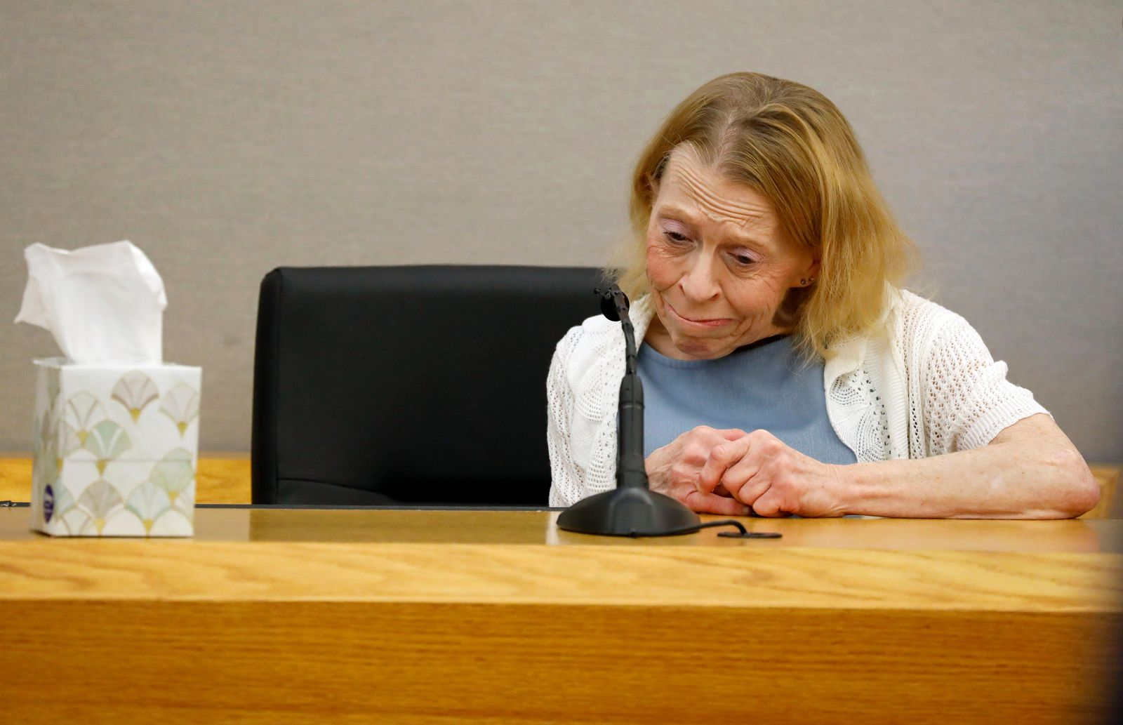 Karen Guyger takes a moment to herself on the witness stand during the sentencing phase of her daughter Amber Guyger's trial, at the Frank Crowley Courts Building in Dallas, Wednesday, Oct. 2, 2019. Guyger, a former Dallas police officer, was convicted of murder Tuesday in the killing of Botham Jean and faces a sentence that could range from five years to life in prison or be lowered to as little as two years if the jury decides the shooting was a crime of sudden passion. (Tom Fox/The Dallas Morning News via AP, Pool)