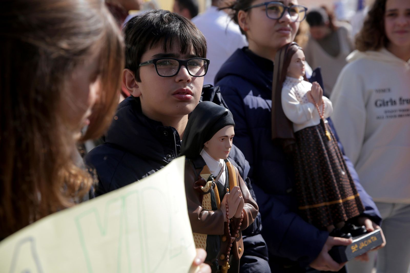 Demonstrators, some of them holding statues of saints, protest outside the Portuguese parliament in Lisbon, Thursday, Feb. 20, 2020. (AP Photo/Armando Franca)