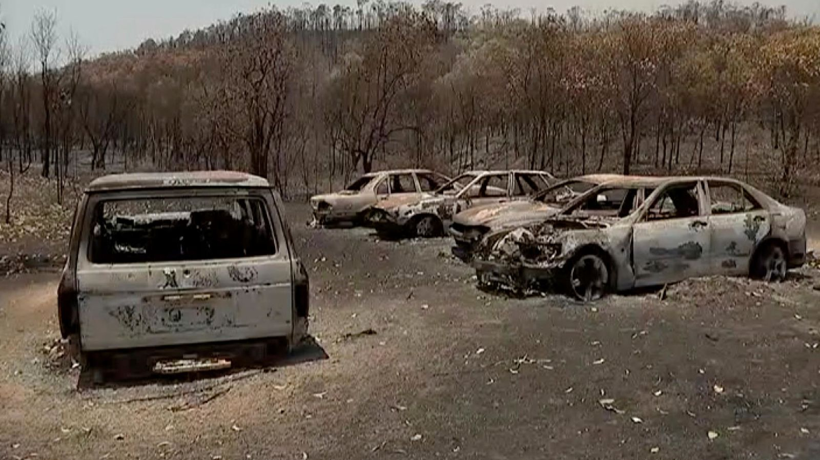 This image made from video shows destroyed cars after wildfires in Yeppoon, Queensland state, Australia, Wednesday, Nov. 13, 2019. (Australian Broadcasting Corporation via AP)