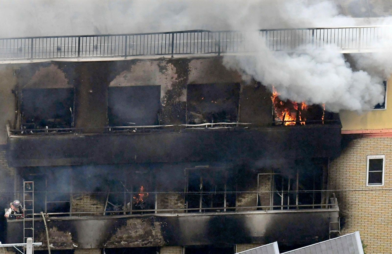 Smoke billows from a Kyoto Animation building in Kyoto, western Japan, Thursday, July 18, 2019. The fire broke out in the three-story building in Japan's ancient capital of Kyoto, after a suspect sprayed an unidentified liquid to accelerate the blaze, Kyoto prefectural police and fire department officials said.(Kyodo News via AP)