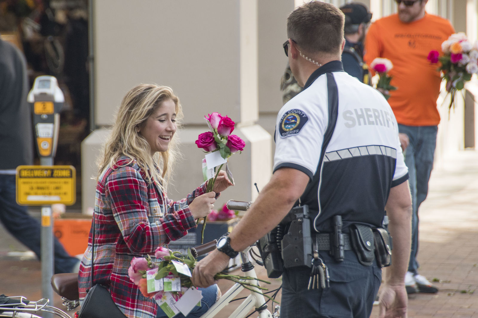 Treasure Valley police and FiftyFlowers.com partnered in Boise to brighten people's day.{ } Volunteers from Treasure Valley police departments and FiftyFlowers.com handed out bouquets{ } in downtown Boise Wednesday hoping to spread happiness to commuters. (Photos by Axel Quartarone)