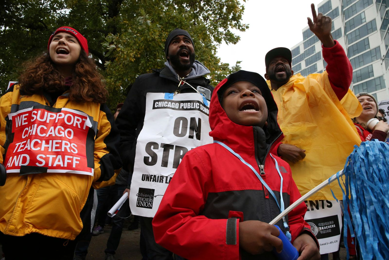 "CPS student. Bryce Kelley, 7, listens to speakers following a march by Chicago Teachers Union members and supporters through the streets of Chicago's Hyde Park neighborhood during the ""Nurse in Every School"" Solidarity March for Justice, on Monday, Oct. 21, 2019. (Antonio Perez/Chicago Tribune via AP)"