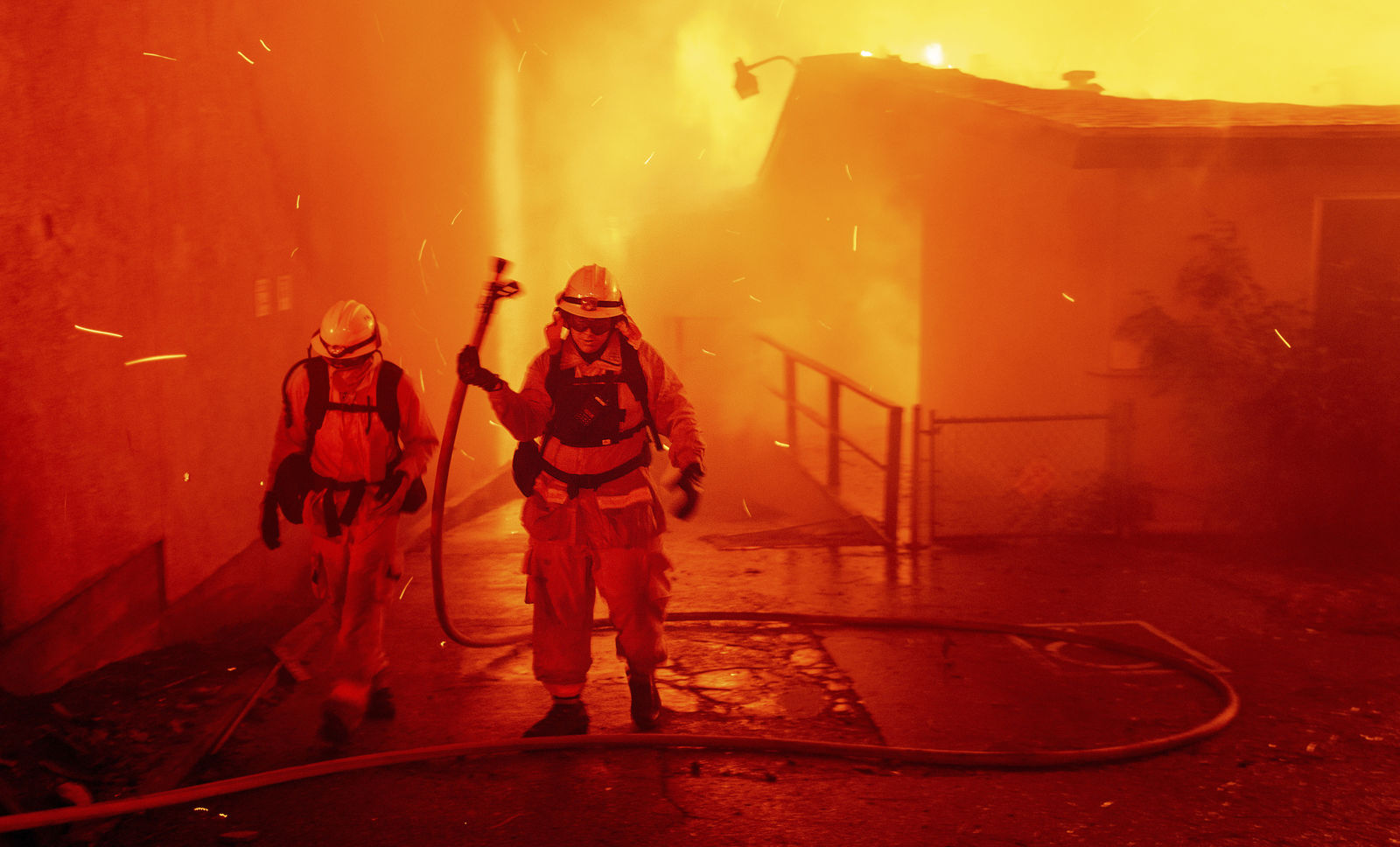 FILE - In this Thursday, Nov. 8, 2018 file photo, firefighters battle the Camp Fire as it tears through Paradise, Calif. (AP Photo/Noah Berger, File)