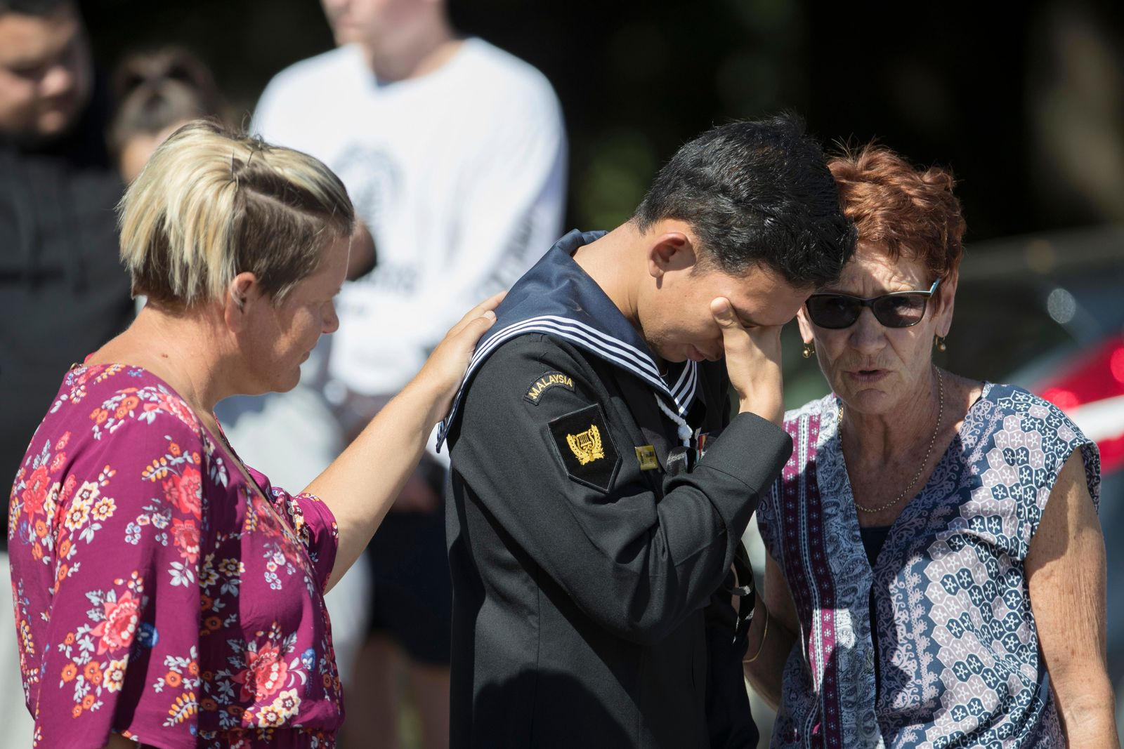 Abdul Iskandar, a sailor of Malaysian Royal Navy, cries after offering flowers outside the Al Noor mosque in Christchurch, New Zealand, Tuesday, March 19, 2019. Christchurch was beginning to return to a semblance of normalcy Tuesday. Streets near the hospital that had been closed for four days reopened to traffic as relatives and friends of Friday's shooting victims continued to stream in from around the world. (AP Photo/Vincent Thian)