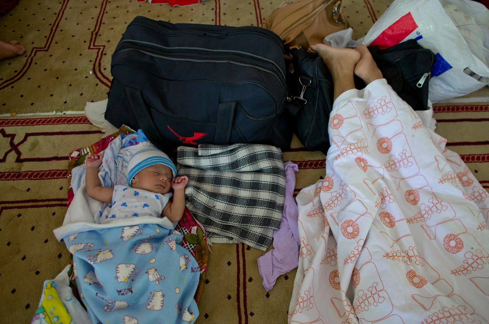 Ten-days old Amdad Ahamed, a son born to Ahmadi Muslim refugee family naps at a community center that they took refuge in Pasyala, north east of Colombo, Sri Lanka, Thursday, April 25, 2019. (AP Photo/Gemunu Amarasinghe)