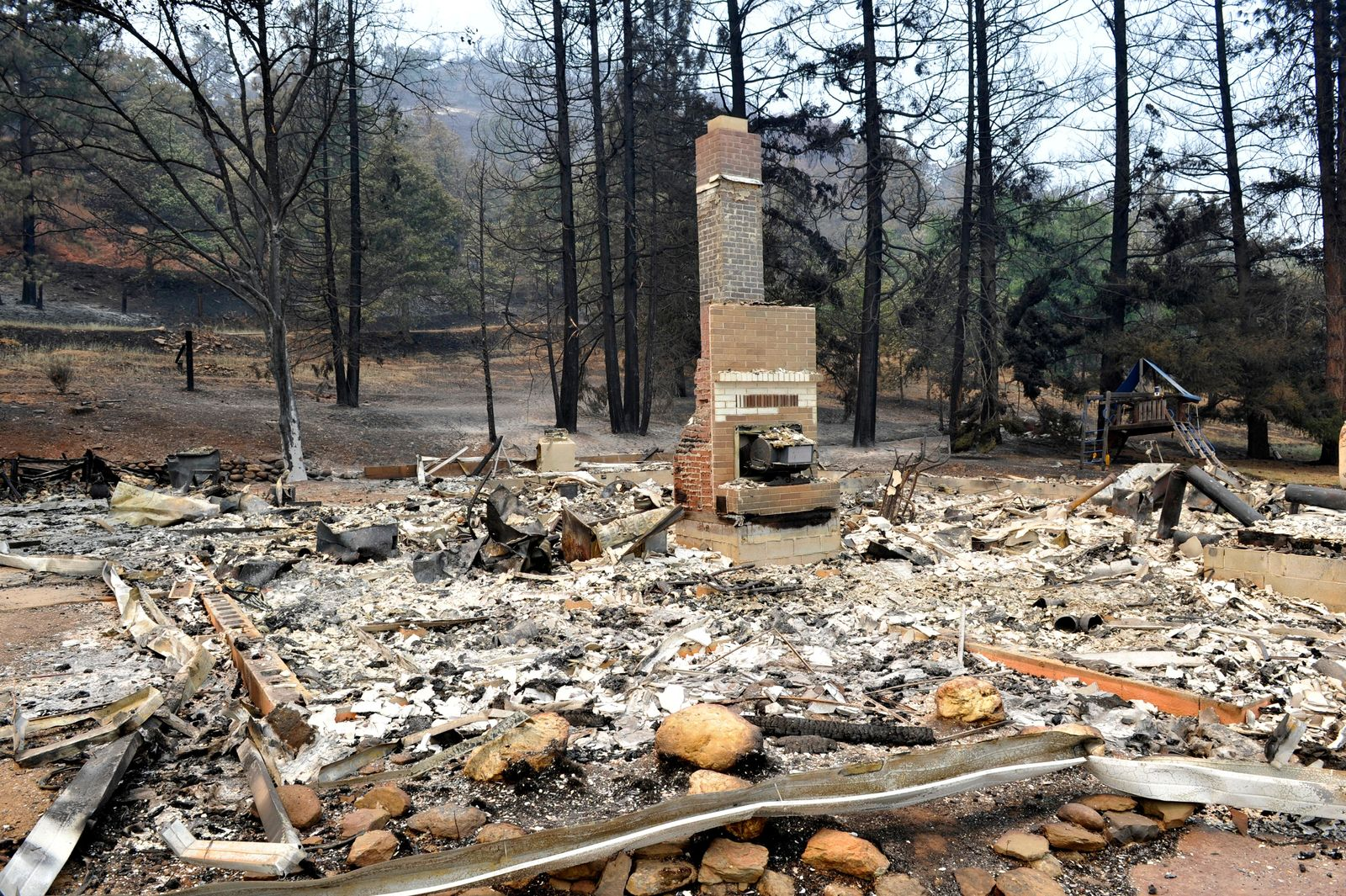 A fire place is all that remains standing from a home lost in the  Klamathon Fire on Cottonwood Creek Road near the town of Hornbrook. (Jamie Lusch / Mail Tribune)