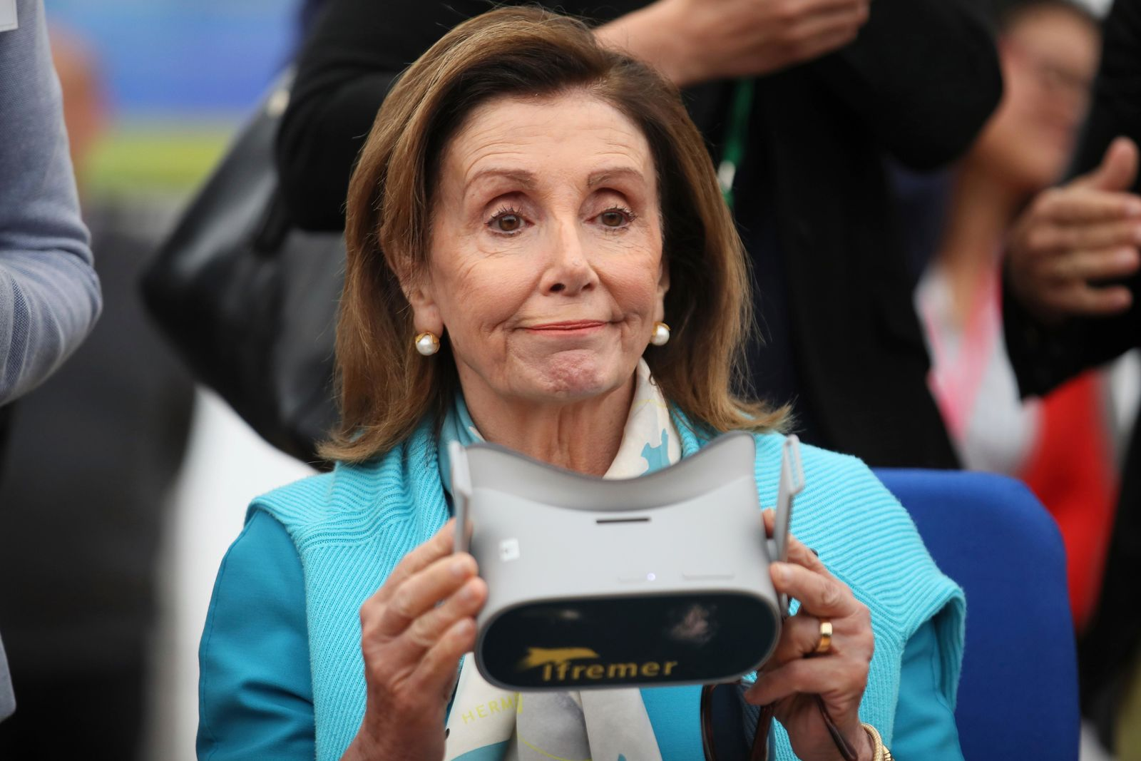 U.S. House Speaker Nancy Pelosi holds a virtual reality mask as she visits the French Research Institute for the Exploitation of the Sea (IFREMER), in Brest, western France, Friday, Sept. 6, 2019. (AP Photo/David Vincent, Pool)