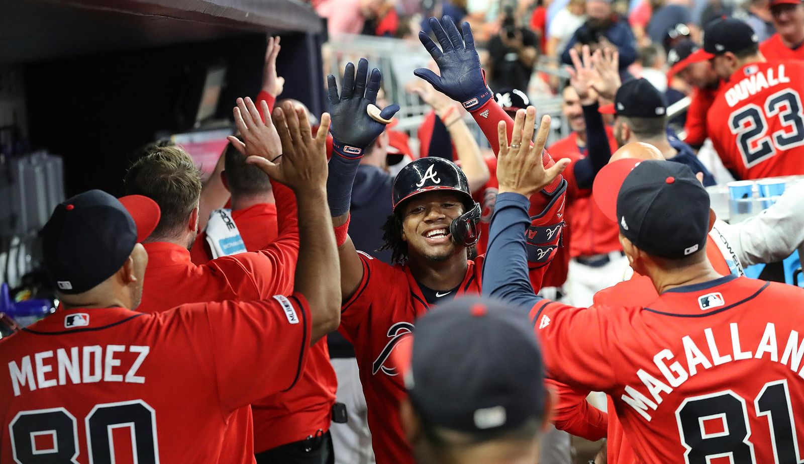 Atlanta Braves' Ronald Acuna Jr., center, reacts after hitting a two-RBI home run against the San Francisco Giants during the fifth inning of a baseball game on Friday, Sept. 20, 2019, in Atlanta. (Curtis Compton/Atlanta Journal-Constitution via AP)