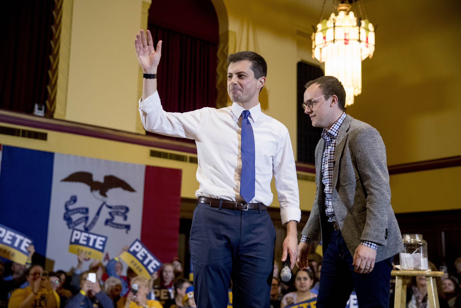Democratic presidential candidate former South Bend, Ind., Mayor Pete Buttigieg, left, and his husband Chasten Buttigieg, right, stand onstage at a campaign stop at Iowa State University, Monday, Jan. 13, 2020, in Aimes, Iowa. (AP Photo/Andrew Harnik)
