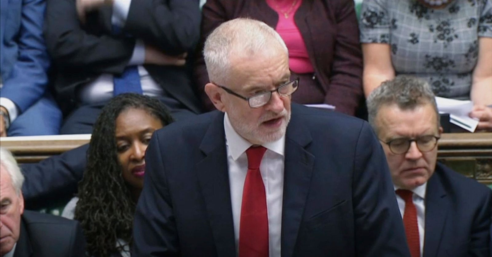 FILE- Britain's Labour Party leader Jeremy Corbyn responds to Prime Minister Boris Johnson's statement to lawmakers inside a crowded House of Commons in FILE- London, Saturday Oct. 19, 2019. (House of Commons via AP)