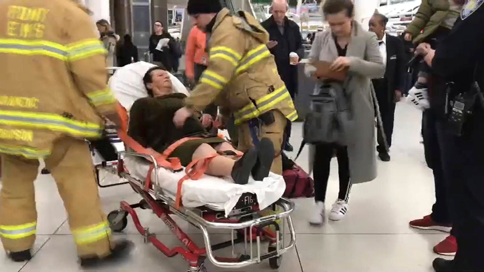 In this still image taken from video provided by WNBC-TV News 4 New York, emergency medical personnel tend to an injured passenger from a Turkish Airlines flight at New York's John F. Kennedy International Airport, Saturday, March 9, 2019. Officials say severe turbulence injured at least 30 people aboard a Turkish Airlines flight from Istanbul that landed safely at New York's Kennedy International Airport on Saturday. (WNBC-TV News 4 New York via AP)
