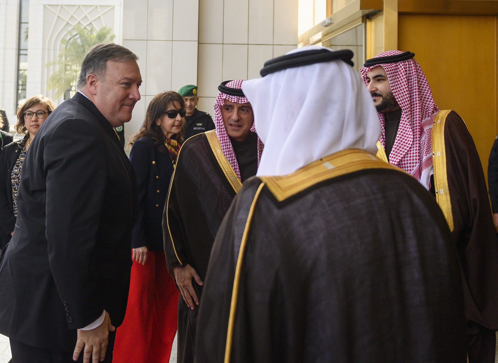 U.S. Secretary of State Mike Pompeo, left, is received by Saudi Minister of State for Foreign Affairs Adel al-Jubeir, center, at the Royal Court, in Riyadh, Saudi Arabia. Monday, January 14, 2019.{ } (Andrew Cabellero-Reynolds/Pool via AP)