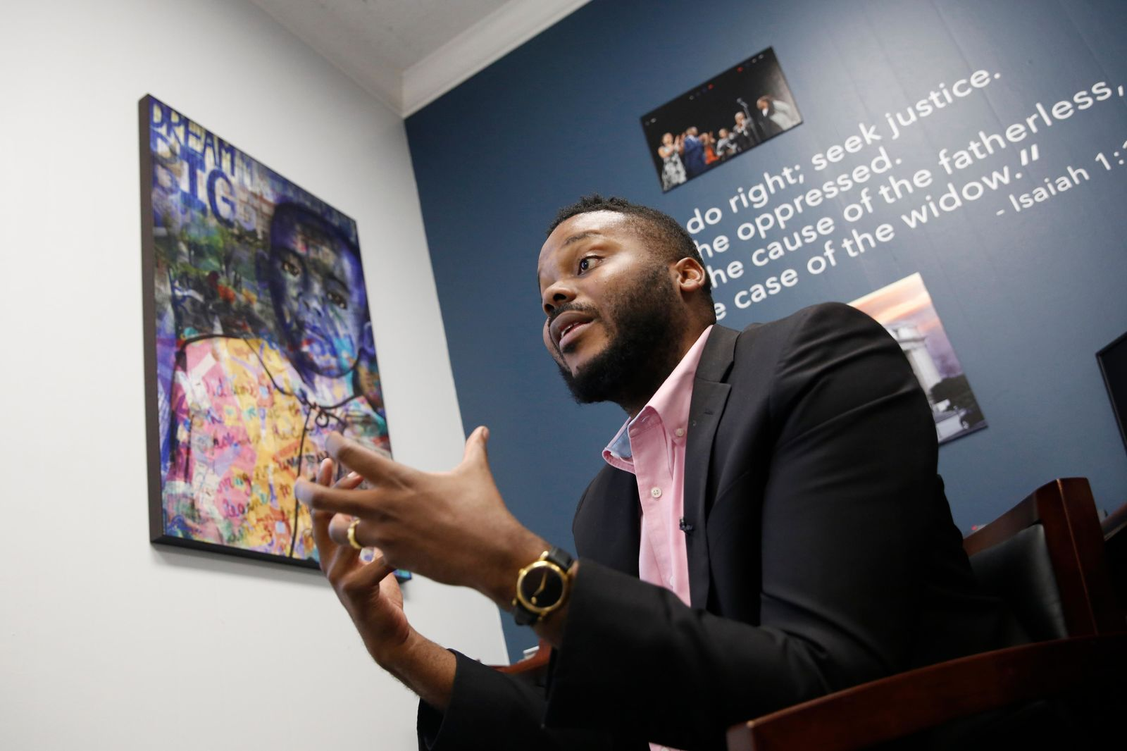 In this photo taken Wednesday Aug. 14, 2019, Stockton Mayor Michael Tubbs discusses a program he initiated to give $500 to 125 people who earn at or below the city's median household income of $46,033 during an interview in Stockton, Calif. (AP Photo/Rich Pedroncelli)