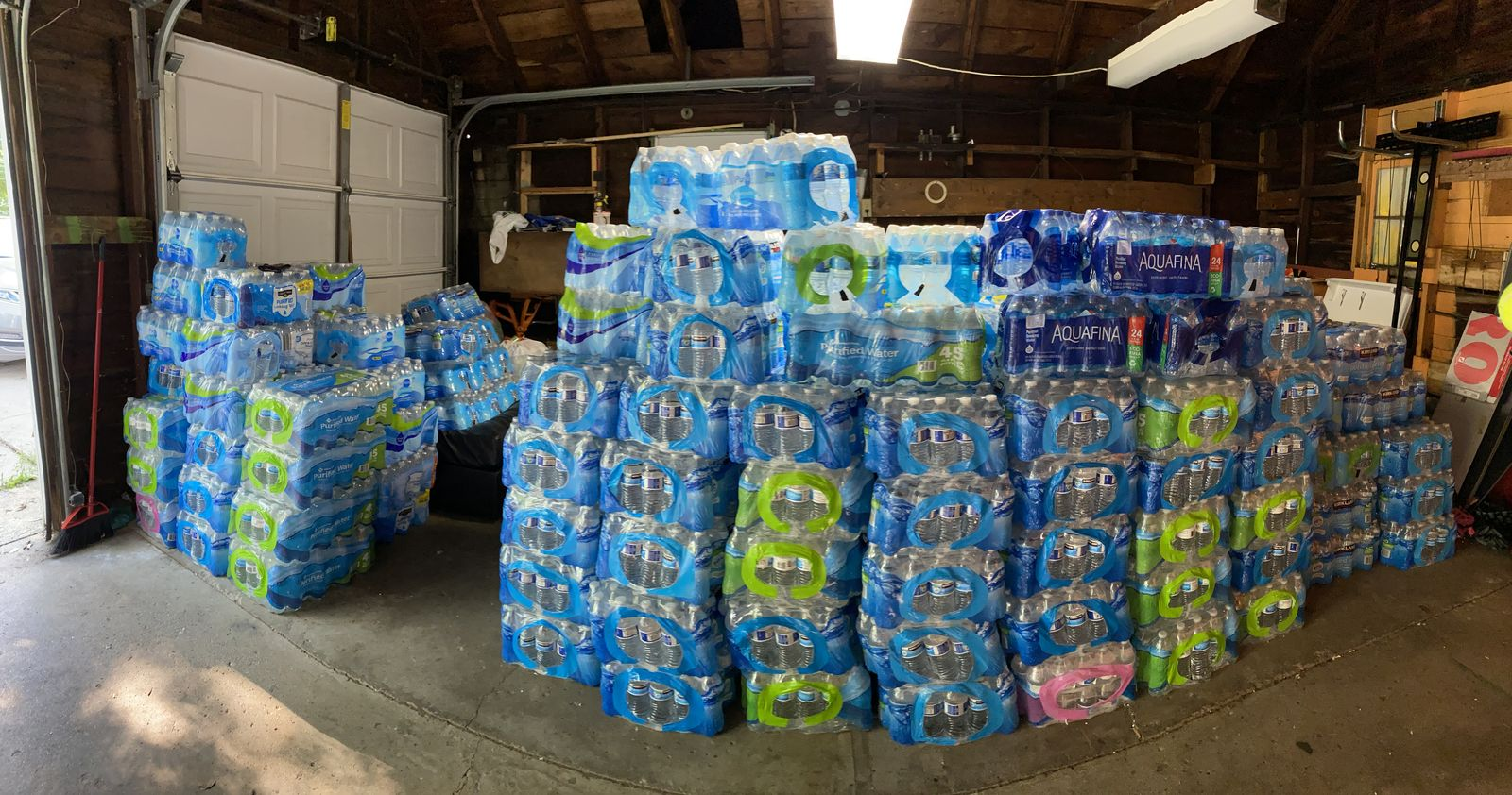 Tamara Custard's garage resembles a water storage warehouse on Tuesday, July 27, 2020. More than 250 cases were in her garage, with another 250 more pledged by local businesses. (WWMT/Jason Heeres)