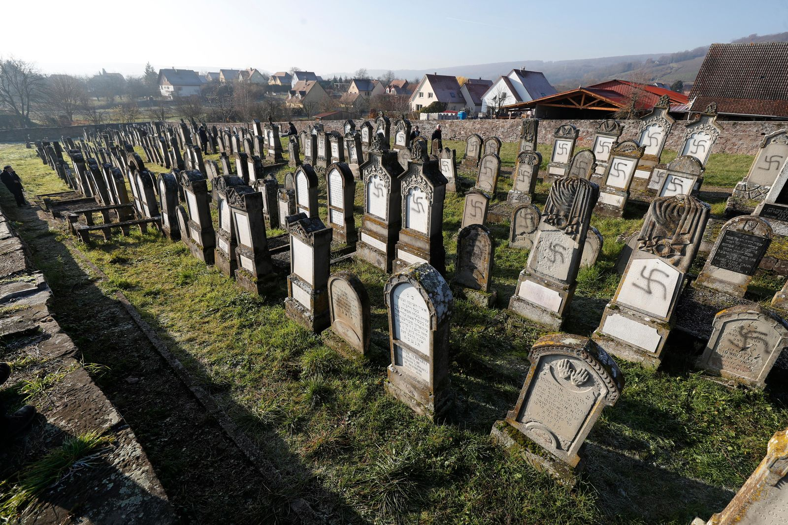 Vandalized tombs are pictured in the Jewish cemetery of Westhoffen, west of the city of Strasbourg, eastern France, Wednesday, Dec. 4, 201 (AP Photo/Jean-Francois Badias)