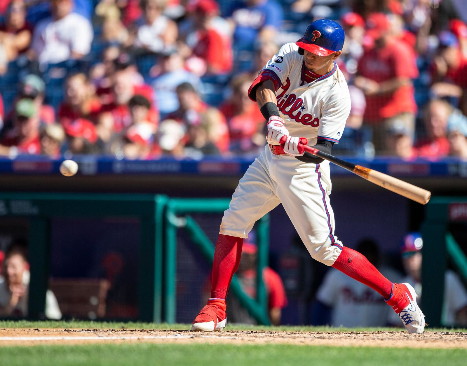 Philadelphia Phillies's Cesar Hernandez swings on a single during the sixth inning of a baseball game against the Boston Red Sox, Sunday, Sept. 15, 2019, in Philadelphia. (AP Photo/Laurence Kesterson)
