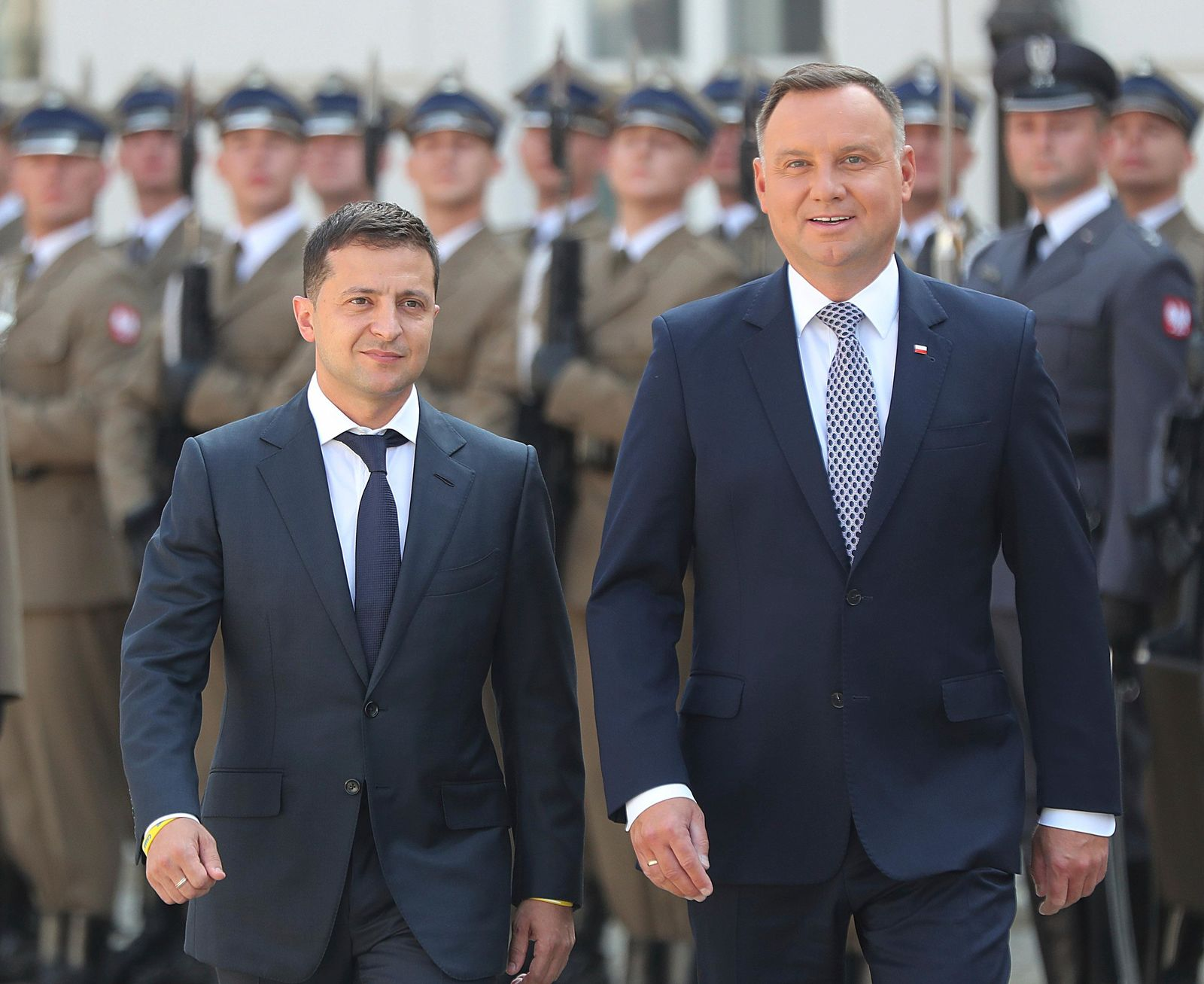 Poland's President Andrzej Duda,right, welcomes Ukraine's President Volodymyr Zelenskiy before talks on bilateral relations and Ukraine's ties with Europe under the new government, in front of the Presidential Place in Warsaw, Poland, Saturday, Aug. 31, 2019. (AP Photo/Czarek Sokolowski)