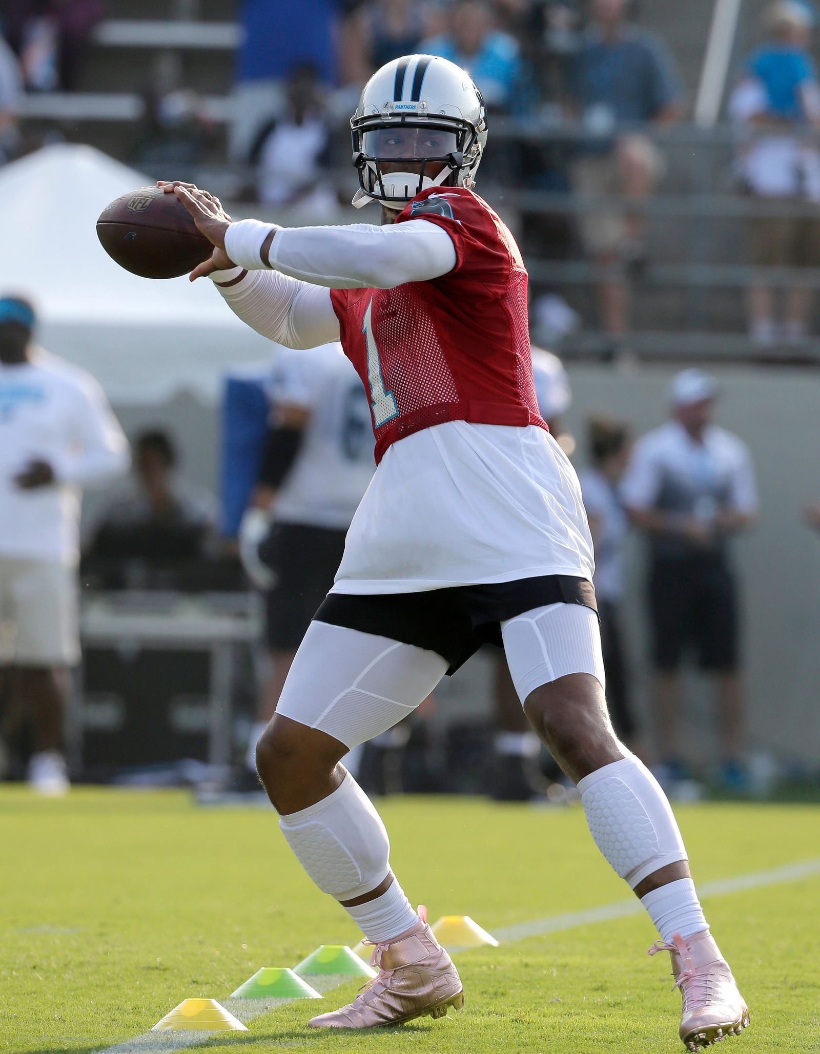 Carolina Panthers' Cam Newton (1) looks to throw a pass during practice at training camp at Wofford College in Spartanburg, S.C., Wednesday, July 26, 2017. (AP Photo/Chuck Burton)