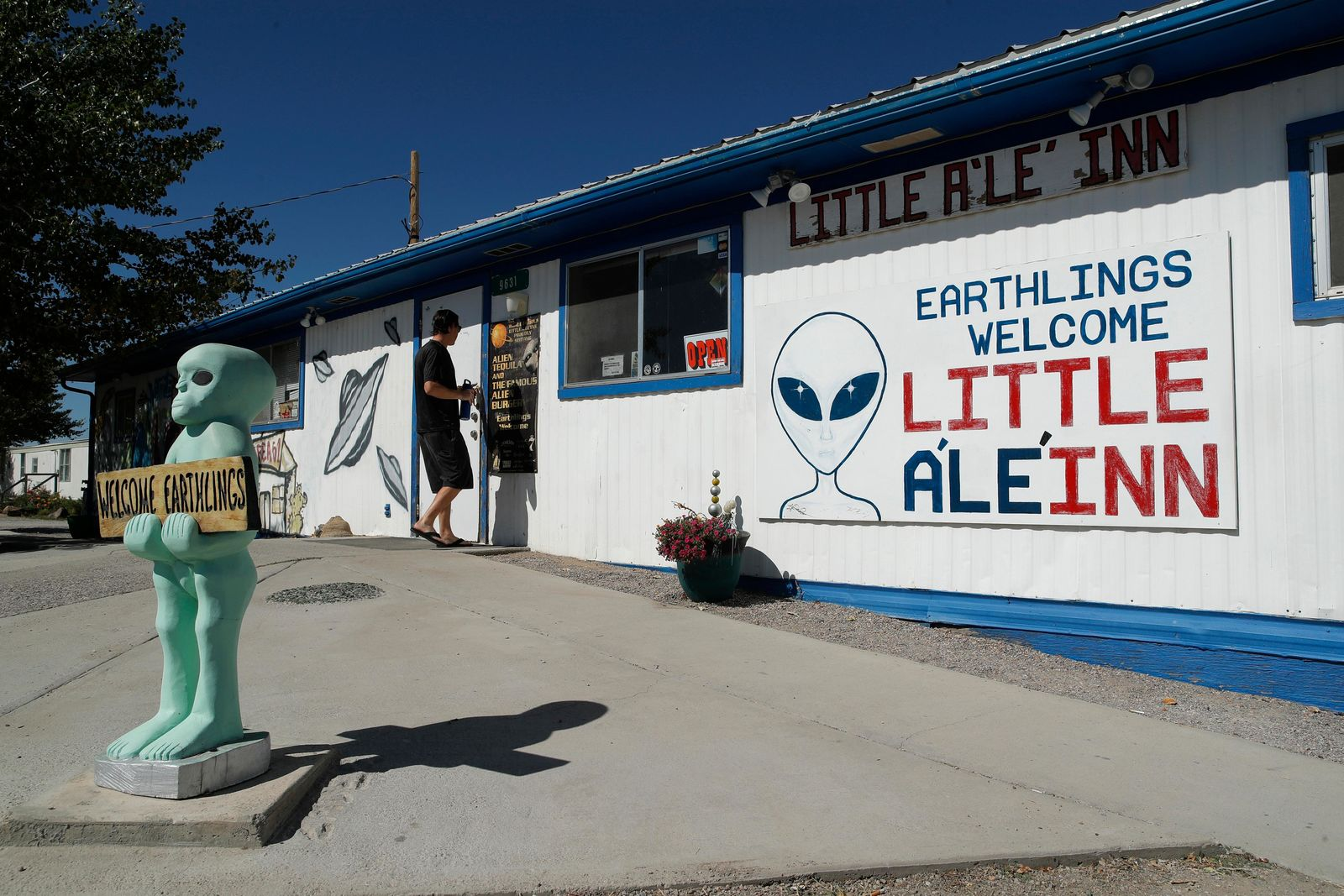 "A person walks into the Little A'Le'Inn, Wednesday, Sept. 18, 2019, in Rachel, Nev. No one knows what to expect, but lots of people are preparing for ""Storm Area 51"" in the Nevada desert. Neighbors, elected officials and experts say the craze sparked by an internet joke inviting people to """"see them aliens"" might become a cultural marker, a dud or something in-between. (AP Photo/John Locher)"