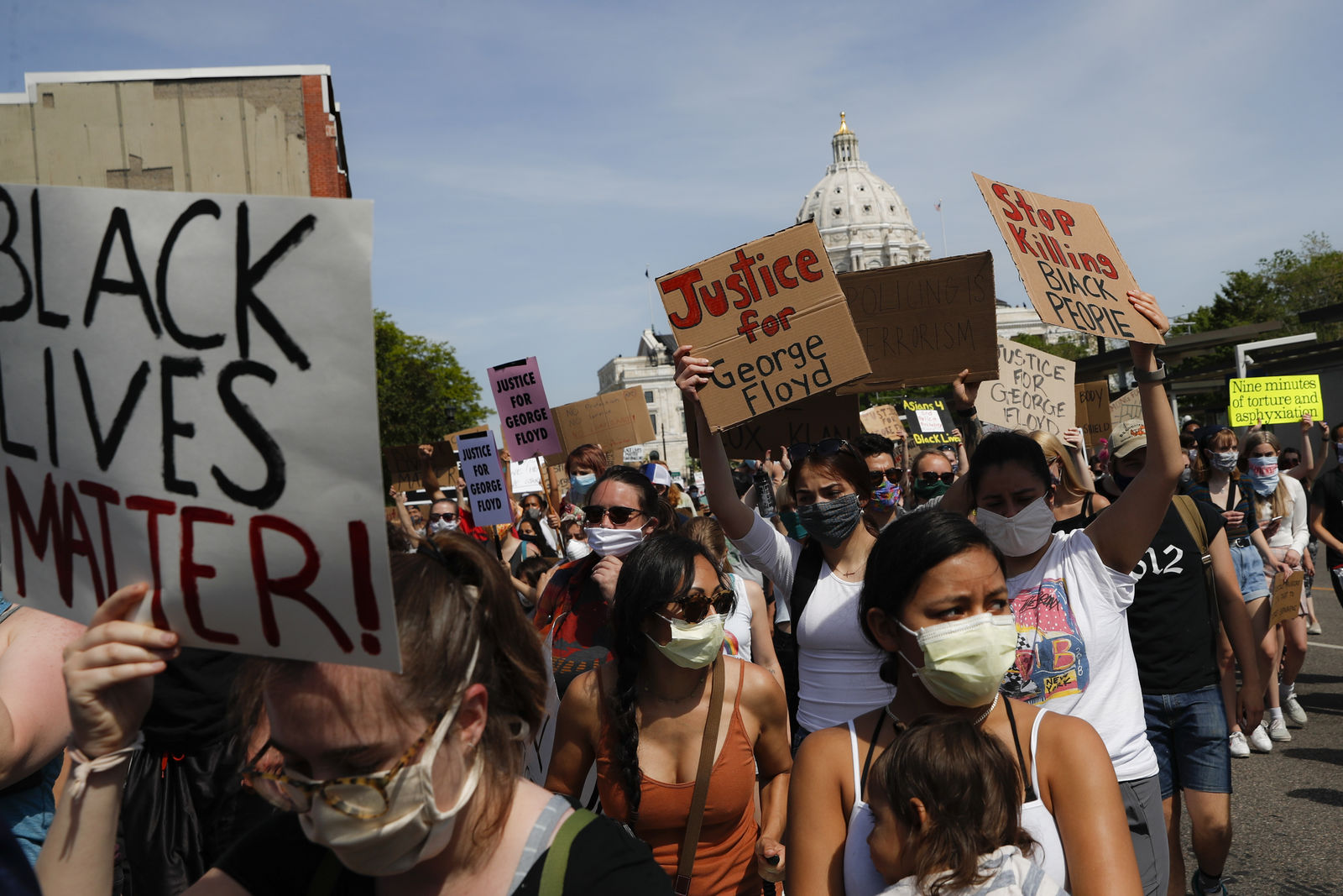 FILE - In this May 31, 2020, file photo, protesters march away from the State Capitol, in St. Paul, Minn. (AP Photo/John Minchillo, File)
