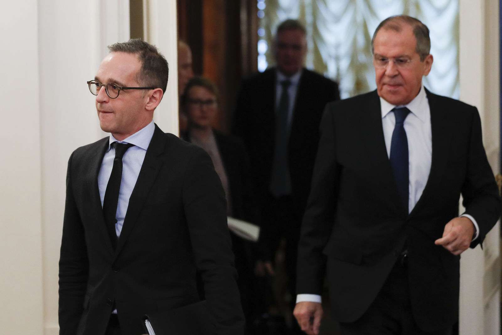 Russian Foreign Minister Sergey Lavrov, right, and Germany's Foreign Minister Heiko Maas enter a hall for their talks in Moscow, Russia, Friday, Jan. 18, 2019. Germany's foreign minister has urged Russia to save a key arms treaty with the U.S. to prevent a new arms race. (AP Photo)