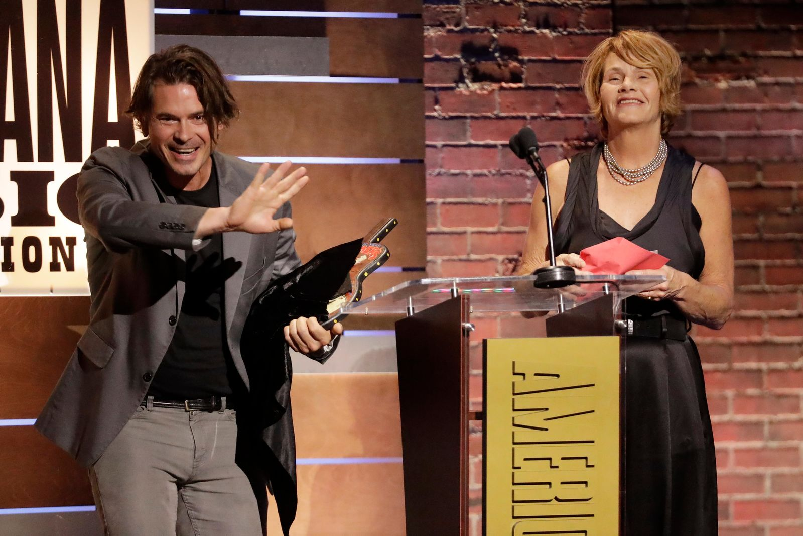Ketch Secor and Shawn Colvin present the Song of the Year Award to John Prine at the Americana Honors & Awards show, Wednesday, Sept. 11, 2019, in Nashville, Tenn. (AP Photo/Wade Payne)
