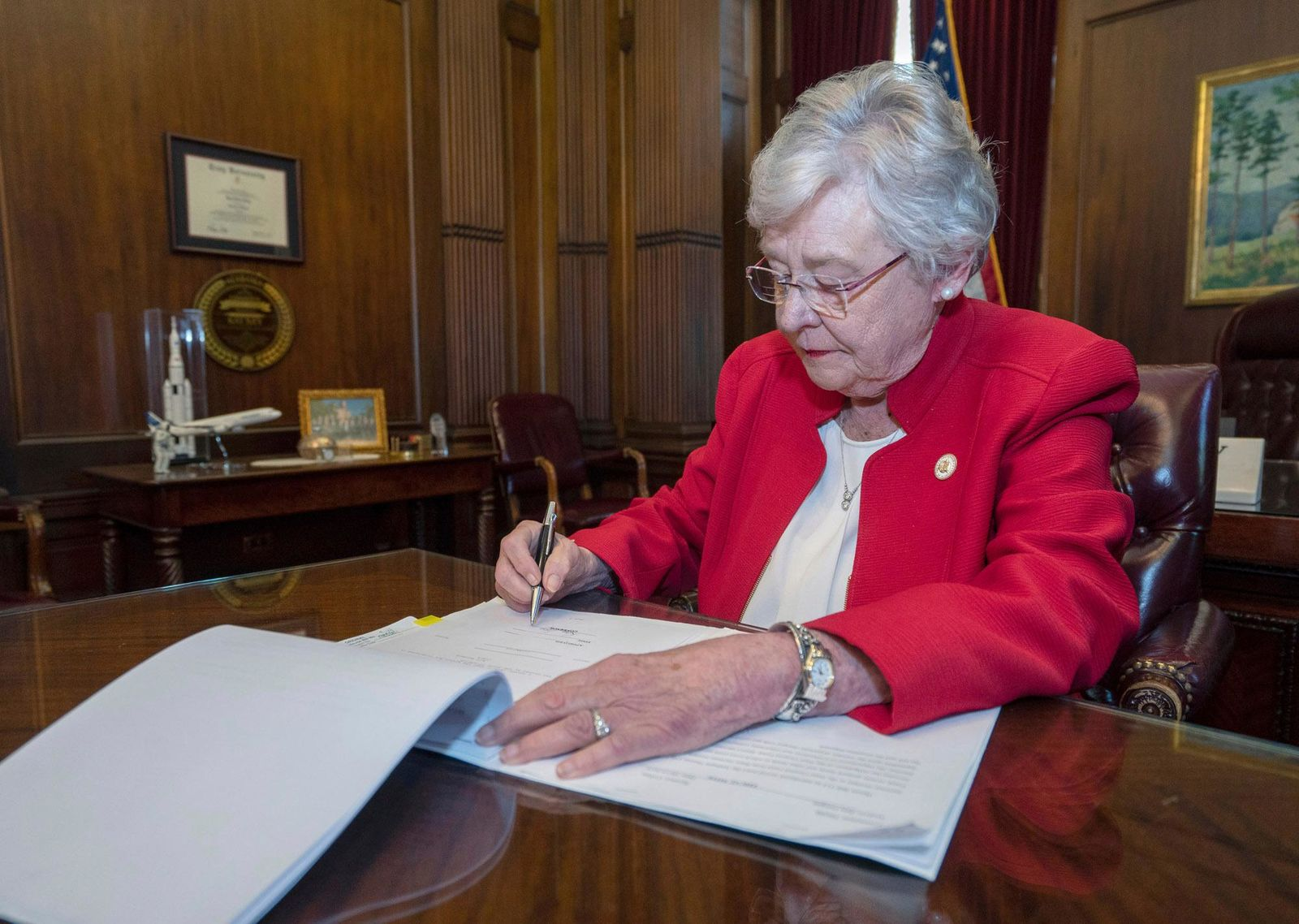 This photograph released by the state shows Alabama Gov. Kay Ivey signing a bill that virtually outlaws abortion in the state on Wednesday, May 15, 2019, in Montgomery, Ala.{ } (Hal Yeager/Alabama Governor's Office via AP)